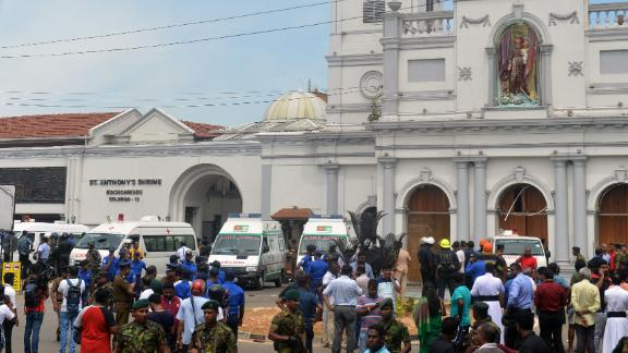 Ambulances are seen outside the church premises with gathered people and security personnel following a blast at the St. Anthony