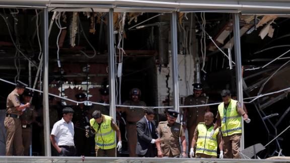 Crime scene investigators inspect the scene of an explosion at the Shangri-La hotel in Colombo.