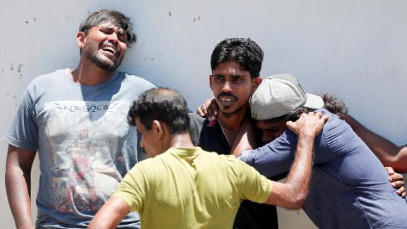 Relatives of bombing victims gather at a mortuary in Colombo.