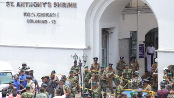 Sri Lankan military officers stand guard in front of St. Anthony