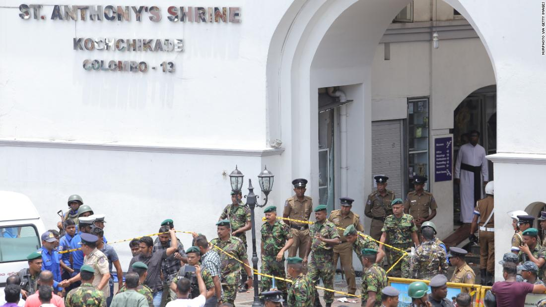 Sri Lankan military officers stand guard in front of St. Anthony's Shrine.