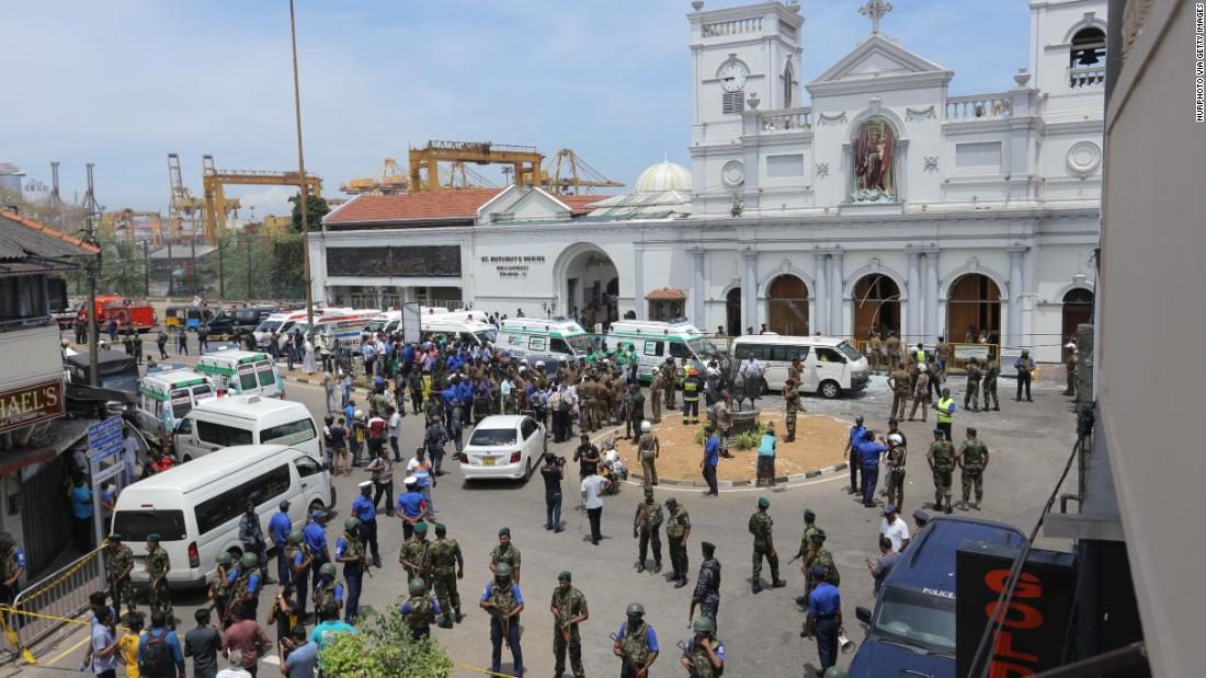 Sri Lankan military members stand guard  outside St. Anthony's Church following an explosion.