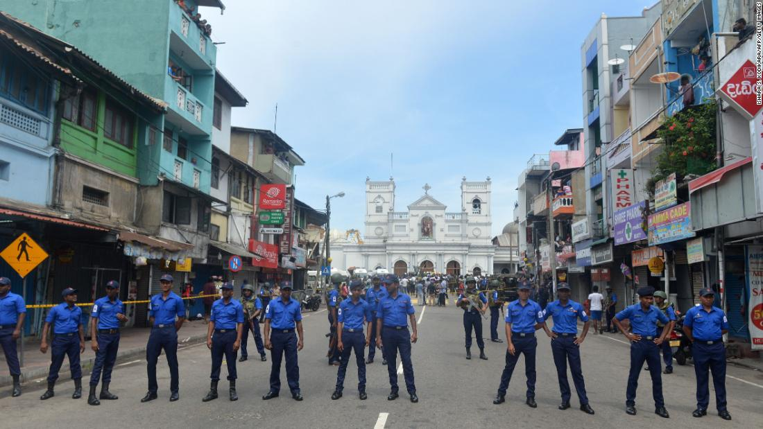 Sri Lankan security personnel keep watch outside St. Anthony's Shrine.
