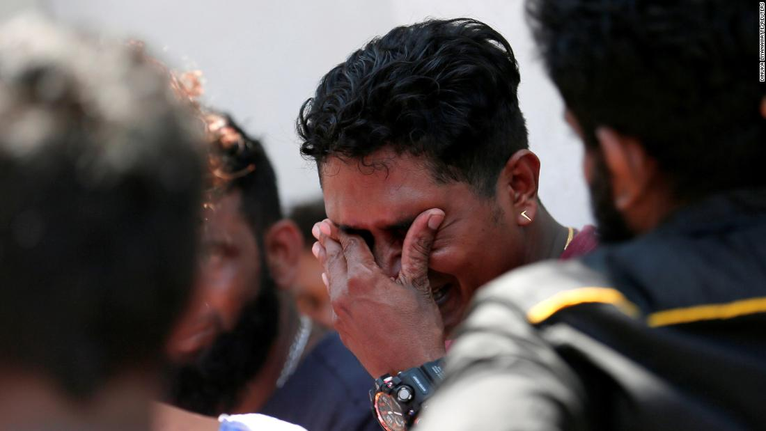 A relative of a victim of an explosion at St. Anthony's Shrine reacts outside the police mortuary in Colombo.