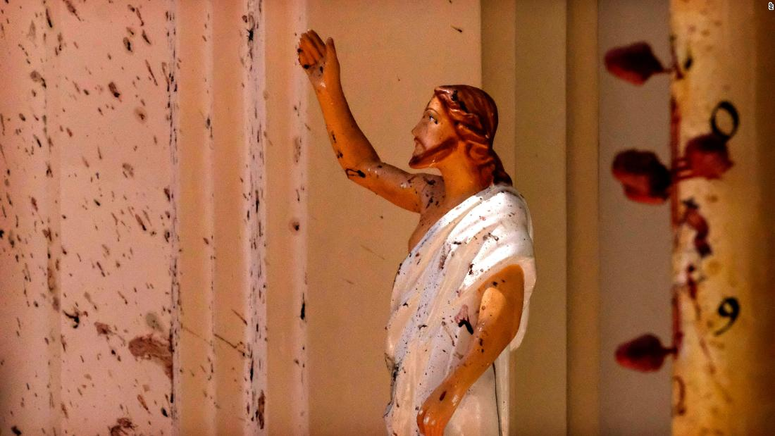 A wall and a statue of Jesus Christ at the St. Sebastian's Church in Negombo are stained with blood.