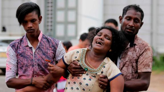 Relatives of a blast victim grieve outside a morgue in Colombo, Sri Lanka, Sunday, April 21, 2019.  More than hundred were killed and hundreds more hospitalized with injuries from eight blasts that rocked churches and hotels in and just outside of Sri Lanka