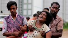 Relatives of a blast victim grieve outside a morgue in Colombo, Sri Lanka, Sunday, April 21, 2019. More than hundred were killed and hundreds more hospitalized with injuries from eight blasts that rocked churches and hotels in and just outside of Sri Lanka's capital on Easter Sunday, officials said, the worst violence to hit the South Asian country since its civil war ended a decade ago. [Eranga Jayawardena/AP)