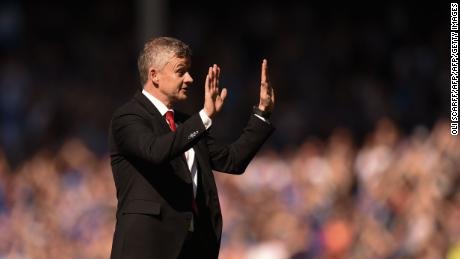 Manchester United manager Ole Gunnar Solskjaer apologizes to the traveling fans after the match.