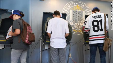 Students vote at a polling station on the campus of the University of California Irvine, on November 6, 2018 in Irvine, California on election day. - Americans vote Tuesday in critical midterm elections that mark the first major voter test of Donald Trump's presidency, with control of Congress at stake. (Photo by Robyn Beck / AFP)        (Photo credit should read ROBYN BECK/AFP/Getty Images)