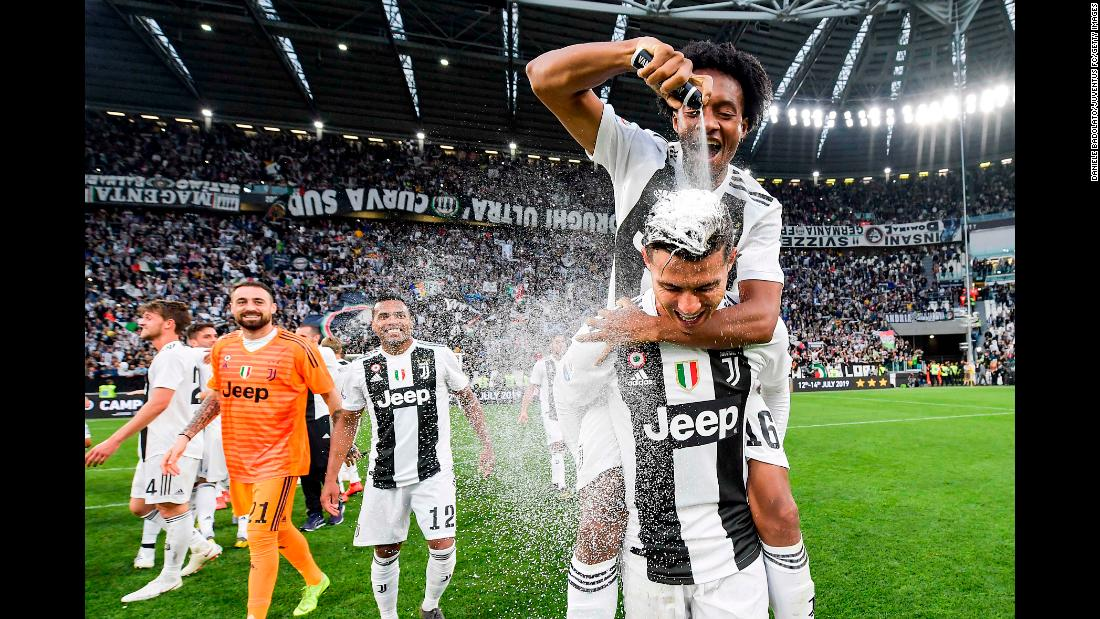 "Cristiano Ronaldo celebrates with Juan Cuadrado after winning the Italian championship Serie A match between Juventus and ACF Fiorentina on Saturday, April 20, in Turin, Italy. The win makes Ronaldo the <a href=""https://www.cnn.com/2019/04/20/football/juventus-champions-serie-a-cristiano-ronaldo-spt-intl/index.html"" target=""_blank"">first player to win</a> the Premier League, La Liga and Serie A."
