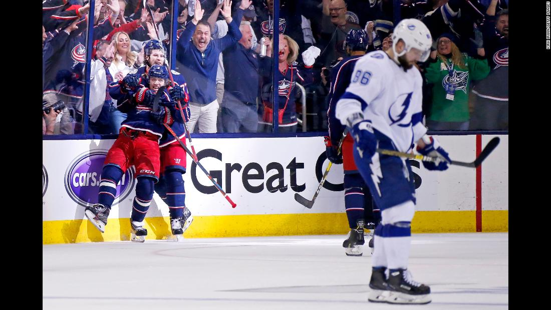 "Artemi Panarin and Josh Anderson of the Columbus Blue Jackets celebrate after scoring an empty net goal in Game 4 of the First Round of the 2019 NHL Stanley Cup Playoffs against the Tampa Bay Lightning on Tuesday, April 16, in Columbus, Ohio. Columbus defeated Tampa Bay 7-3 to win the series 4-0. It was the <a href=""https://bleacherreport.com/articles/2831701-blue-jackets-win-1st-ever-playoff-series-with-historic-sweep-of-lightning"" target=""_blank"">first ever playoff series win</a> for the Blue Jackets franchise."