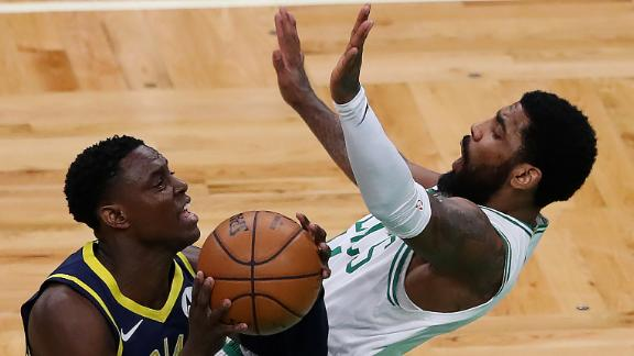 Darren Collison, left, of the Indiana Pacers, charges Kyrie Irving of the Boston Celtics during an April game in Boston.