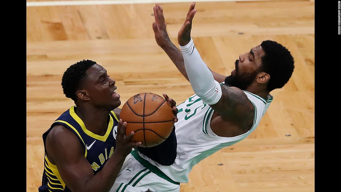 Darren Collison of the Indiana Pacers, left, charges into Kyrie Irving of the Boston Celtics during the first quarter on Wednesday, April 17, in Boston.