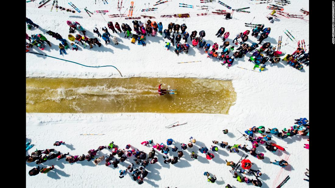 A skier glides over a pool of a water during a waterslide contest at the Nendaz ski resort in Switzerland on Saturday, April 20.