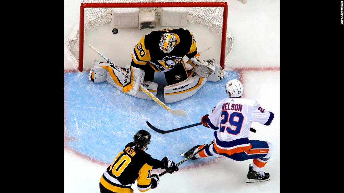 "Brock Nelson of the New York Islanders scores on Pittsburgh Penguins goaltender Matt Murray during the first period of Game 4 of their NHL first-round playoff series in Pittsburgh on Tuesday, April 16. The <a href=""https://bleacherreport.com/articles/2831685-islanders-complete-series-sweep-of-sidney-crosby-penguins-with-3-1-game-4-win"" target=""_blank"">Islanders won the game 3-1</a>, sweeping the Penguins to advance to the second round."