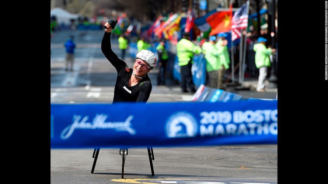 Manuella Schar of Switzerland celebrates before crossing the finish line to win the Women's Wheelchair Division of the 123rd Boston Marathon on Monday, April 15.