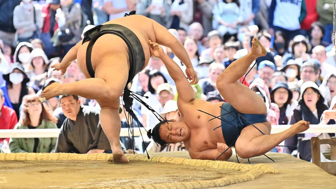 "Sumo wrestlers take part in a ""honozumo,"" a ceremonial sumo exhibition, on the grounds of Yasukuni Shrine in Tokyo on Monday, April 15. Some of Sumo's top wrestlers took part in the annual one-day exhibition."
