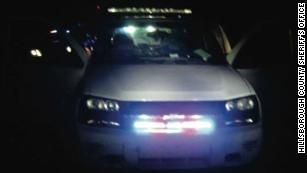 The 2007 white Chevrolet Trailblazer that attempted to pull over an undercover detective.