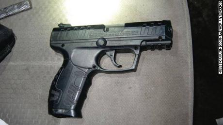 The realistic-looking airsoft pistol in the fake representative vehicle.