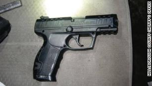 The realistic-looking airsoft pistol found in the fake deputy's vehicle.