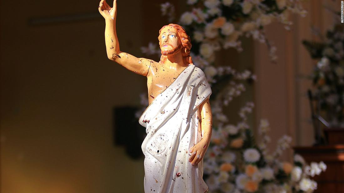 Blood stains are seen on a statue of Jesus Christ after a bomb blast inside a church in Negombo, on Sunday.