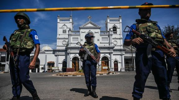 Security personnel stand guard outside St. Anthony