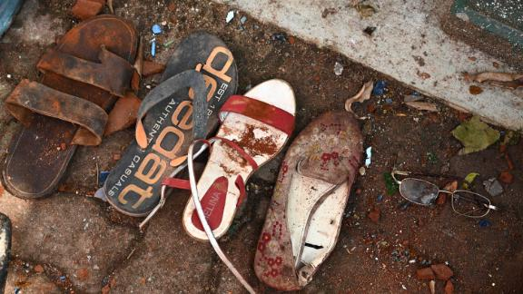 Shoes and belongings of victims are collected as evidence at St. Sebastian