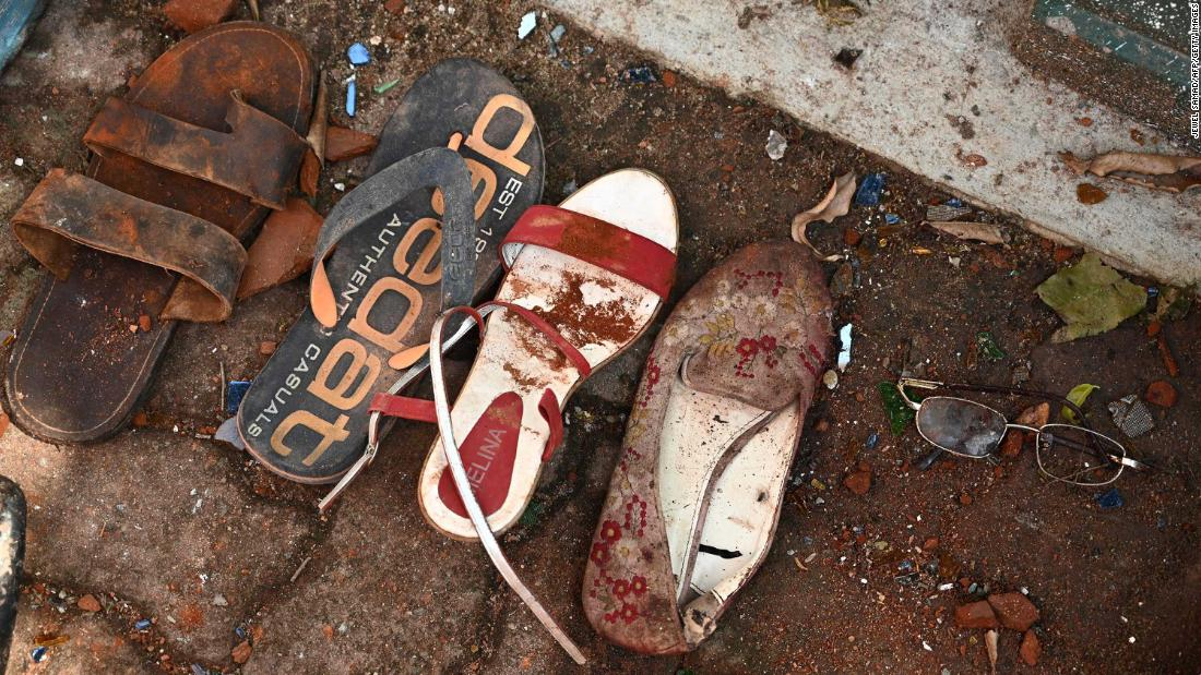 Shoes and belongings of victims are collected as evidence at St. Sebastian's Church in Negombo on Monday, April 22.