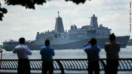 The Norfolk-based USS Arlington joins the Parade of Ships as it makes its way past the Statue of Liberty on the opening day of Fleet Week on May 23, 2018 in New York City.