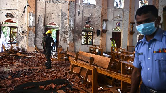 Security personnel inspect the interior of St Sebastian