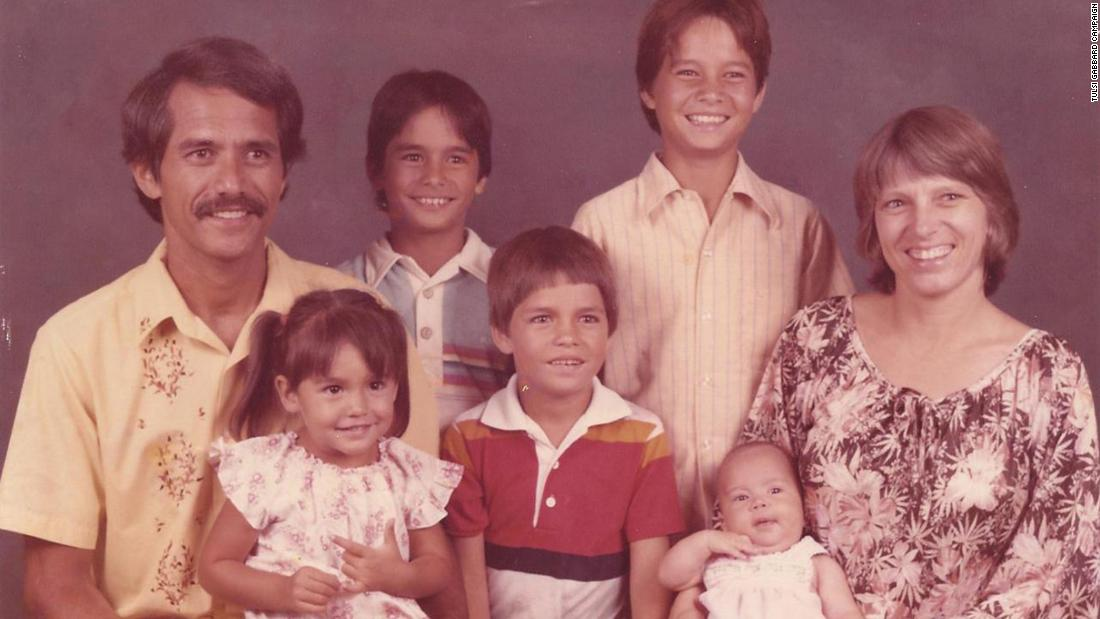 Gabbard, lower left, poses for a family portrait in 1984. She is the fourth of five children.