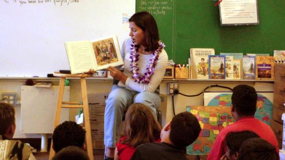Gabbard reads to elementary school students in 2002. That year, she was elected to Hawaii's House of Representatives. At 21,  she was the youngest woman ever elected to the state legislature.