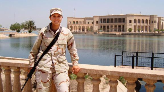 Gabbard poses in front of the Al-Faw Palace in Baghdad, Iraq, in 2005.