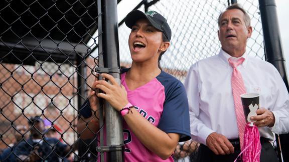 Gabbard and House Speaker John Boehner watch the Congressional Women's Softball Game in June 2013.