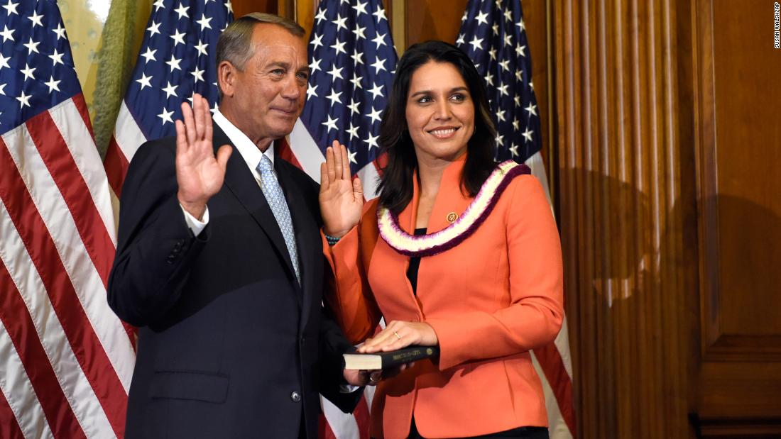After winning re-election in 2014, Gabbard re-enacts her swearing-in with House Speaker John Boehner.