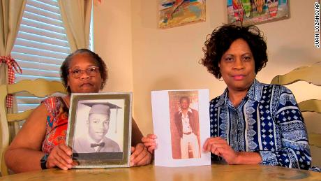 Louvon Byrd, left, and Mylinda Byrd Washington display photos of their late brother earlier this month.