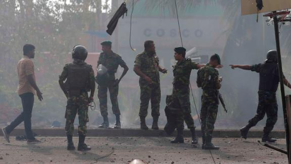 Sri Lankan security forces stand at the site near St. Anthony