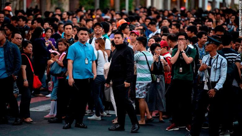 Employees seen in Manila, after an earthquake rocked high-rise buildings there.