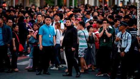 Employees seen in Manila after an earthquake waved high-rise buildings there.