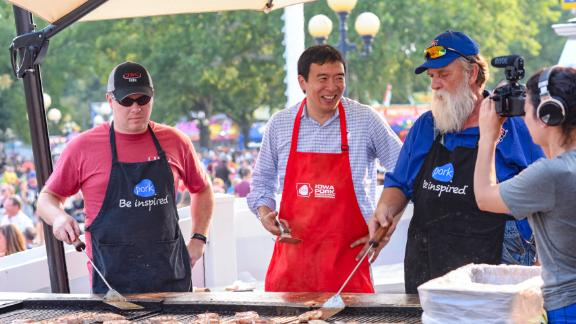 Yang helps man the grill at the Iowa State Fair.