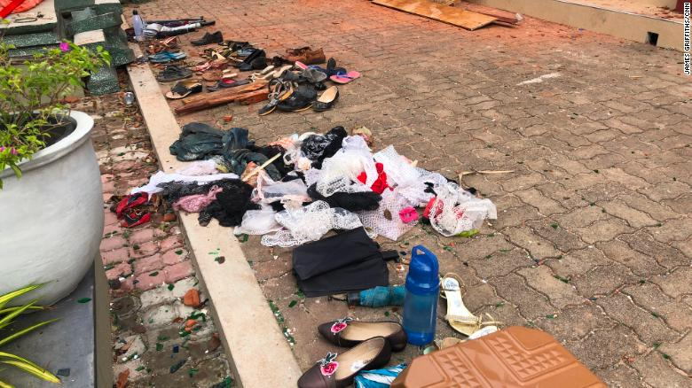 Shoes and clothes removed from St. Sebastian's Church lie on the ground.