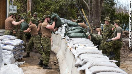 Members of the Canadian Army prepare flooding defenses in Laval, Quebec, where water was at a dangerous level on Sunday.