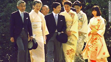 Emperor Akihito and Empress Michiko, left, lead their two sons, accompanied by their spouses and a daughter, during the annual Imperial Garden Party in the fall of 1997 at the Akasaka Palace in Tokyo.