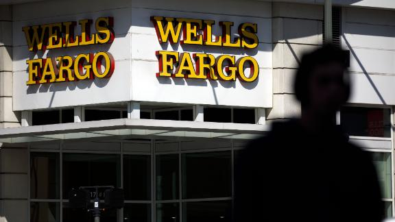 Signage is displayed outside a Wells Fargo & Co. bank branch in Los Angeles, California, U.S., on Thursday, April 19, 2018. Wells Fargo & Co.'s financial ties to gunmakers and the National Rifle Association have prompted the American Federation of Teachers to remove the bank from its list of recommended mortgage lenders. Photographer: Patrick T. Fallon/Bloomberg via Getty Images