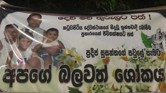 Posters with photos of blast victims are seen outside St Sebastian Church in Negombo. This one reads,