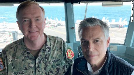 Adm. James Foggo and Ambassador Jon Huntsman on the bridge of USS Abraham Lincoln.