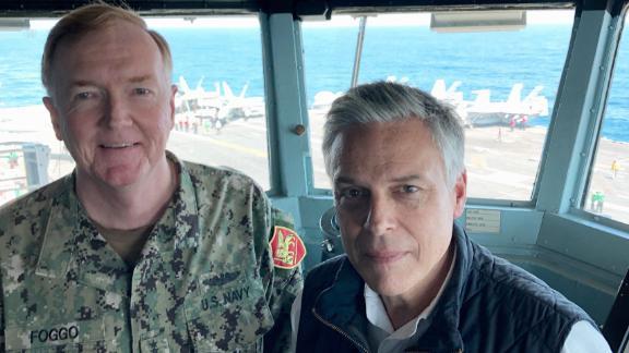 Adm. James Foggo and Ambassador Jon Huntsman on the bridge of the USS Abraham Lincoln.