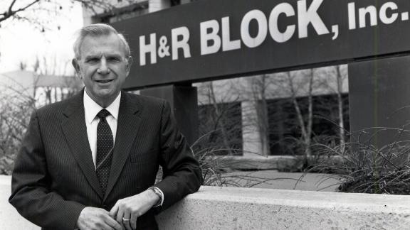 Henry Bloch stands in front of one of H&R Blocks