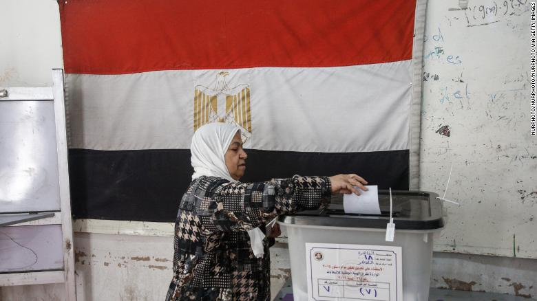 A woman casts her ballot in Cairo.