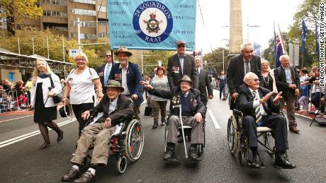 War veterans make their way down Elizabeth Street during the Anzac Day parade on April 25, 2018 in Sydney, Australia.